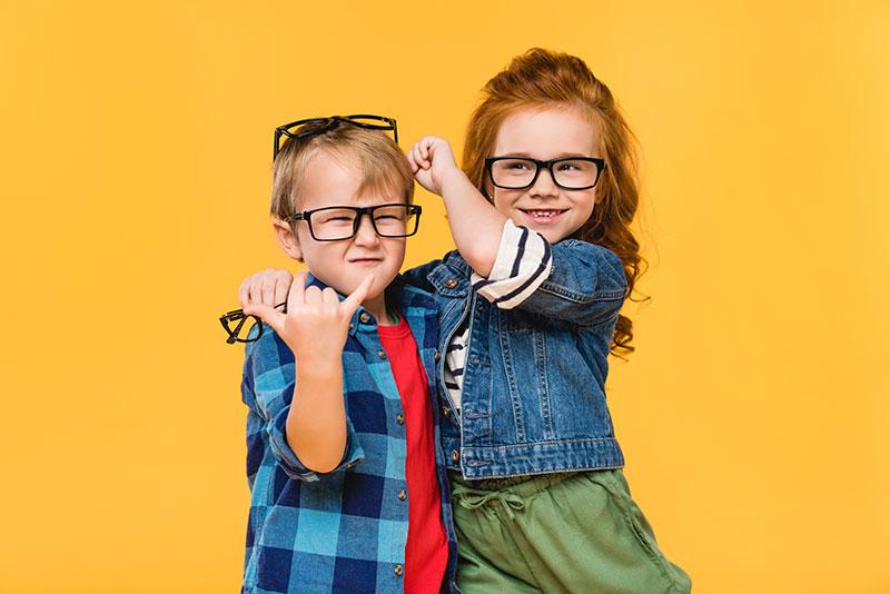 kids trying on eyeglasses